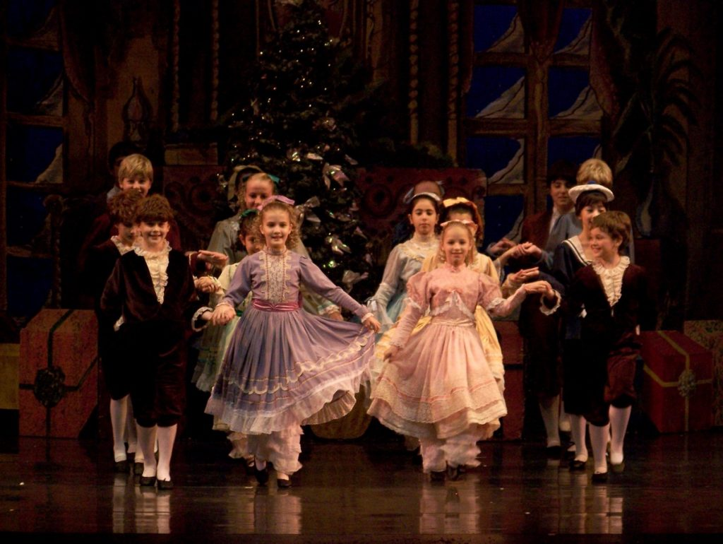 Students performing on stage in The Nutcracker