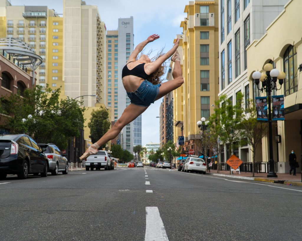 Athena leaping mid street